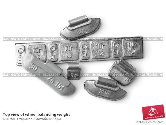Купить «Top view of wheel balancing weight», фото № 26752526, снято 2 ноября 2016 г. (c) Антон Стариков / Фотобанк Лори