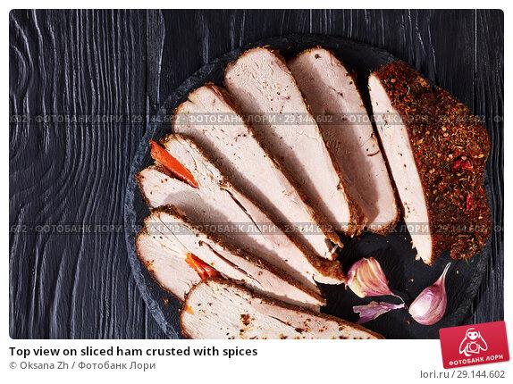 Купить «Top view on sliced ham crusted with spices», фото № 29144602, снято 3 сентября 2018 г. (c) Oksana Zh / Фотобанк Лори