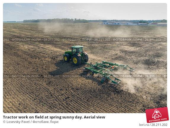 Купить «Tractor work on field at spring sunny day. Aerial view», фото № 28211202, снято 19 августа 2015 г. (c) Losevsky Pavel / Фотобанк Лори