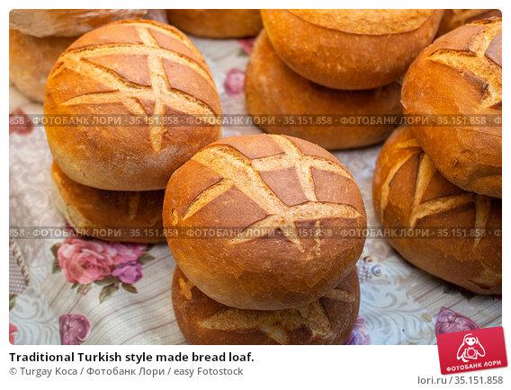 Traditional Turkish style made bread loaf. Стоковое фото, фотограф Turgay Koca / easy Fotostock / Фотобанк Лори