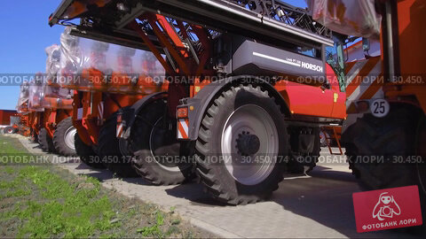Trailed agricultural equipment. Products of the plant for the production of agricultural machinery. Стоковое видео, видеограф Андрей Радченко / Фотобанк Лори