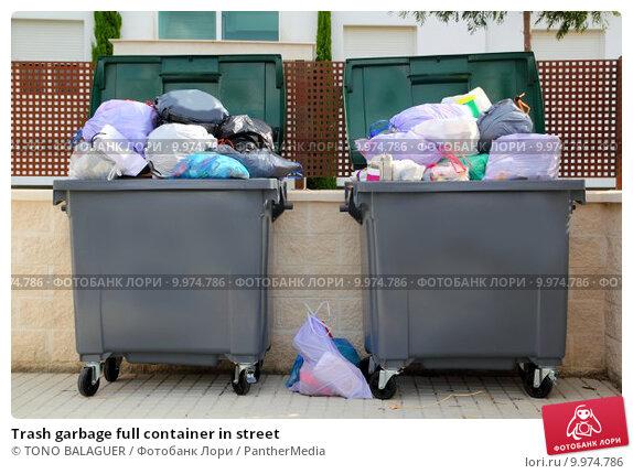 Купить «Trash garbage full container in street», фото № 9974786, снято 7 июня 2019 г. (c) PantherMedia / Фотобанк Лори