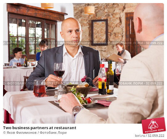 Two business partners at restaurant. Стоковое фото, фотограф Яков Филимонов / Фотобанк Лори