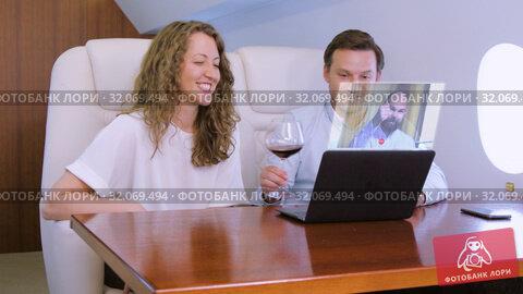 Two businessmen make video call on private plane. Стоковое видео, видеограф Сергей Петерман / Фотобанк Лори
