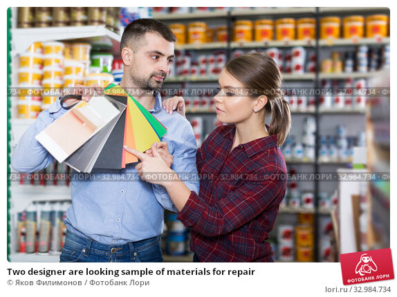 Купить «Two designer are looking sample of materials for repair», фото № 32984734, снято 16 февраля 2018 г. (c) Яков Филимонов / Фотобанк Лори