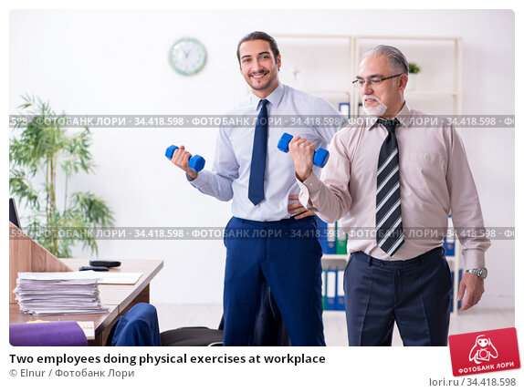 Two employees doing physical exercises at workplace. Стоковое фото, фотограф Elnur / Фотобанк Лори