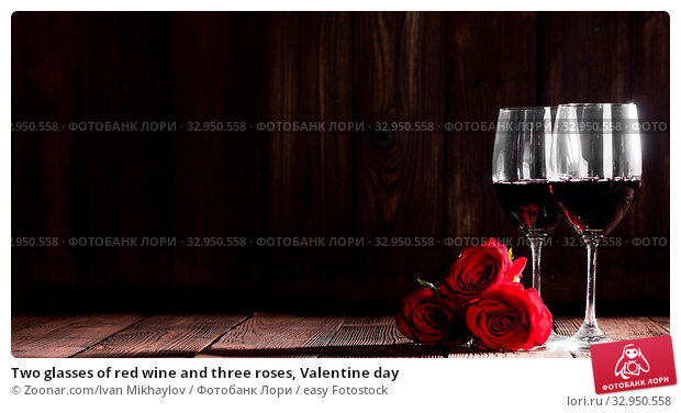 Two glasses of red wine and three roses, Valentine day. Стоковое фото, фотограф Zoonar.com/Ivan Mikhaylov / easy Fotostock / Фотобанк Лори