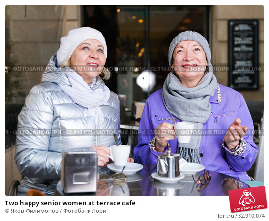Two happy senior women at terrace cafe. Стоковое фото, фотограф Яков Филимонов / Фотобанк Лори