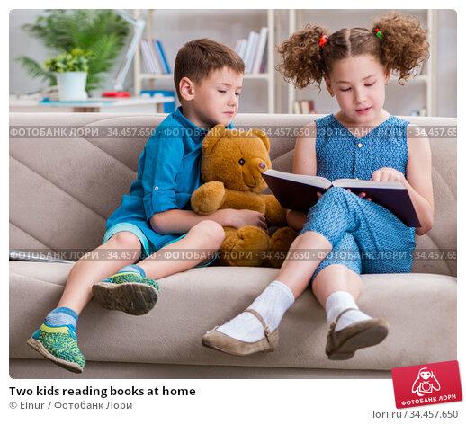 Two kids reading books at home. Стоковое фото, фотограф Elnur / Фотобанк Лори