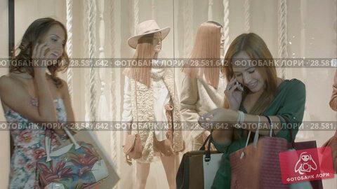 Купить «Two lovely girls talking by the phone at the same time in the mall.», видеоролик № 28581642, снято 18 ноября 2015 г. (c) Vasily Alexandrovich Gronskiy / Фотобанк Лори