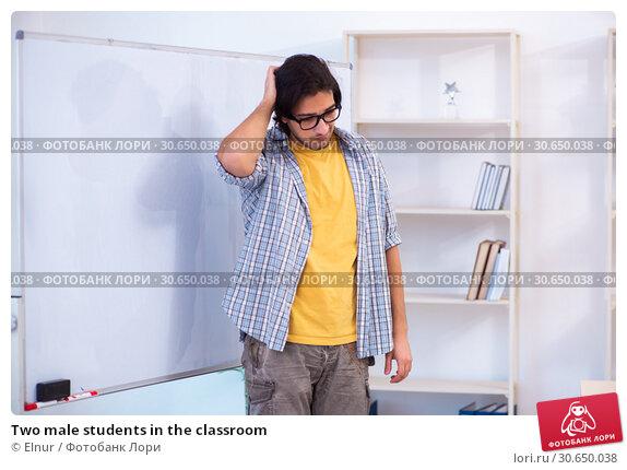 Купить «Two male students in the classroom», фото № 30650038, снято 22 февраля 2019 г. (c) Elnur / Фотобанк Лори