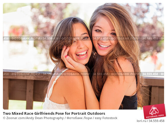 Two Mixed Race Girlfriends Pose for Portrait Outdoors. Стоковое фото, фотограф Zoonar.com/Andy Dean Photography / easy Fotostock / Фотобанк Лори