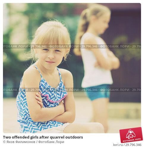 Купить «Two offended girls after quarrel outdoors», фото № 29796346, снято 20 июля 2017 г. (c) Яков Филимонов / Фотобанк Лори