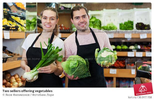 Купить «Two sellers offering vegetables», фото № 30917158, снято 27 апреля 2019 г. (c) Яков Филимонов / Фотобанк Лори