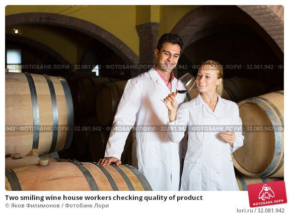 Купить «Two smiling wine house workers checking quality of product», фото № 32081942, снято 21 сентября 2016 г. (c) Яков Филимонов / Фотобанк Лори