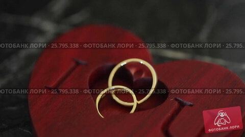 Two wedding rings and i love you sign, видеоролик № 25795338, снято 16 марта 2016 г. (c) Алексей Макаров / Фотобанк Лори