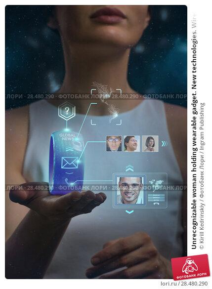 Купить «Unrecognizable woman holding wearable gadget. New technologies. Wireless tools. Future communications and social media concept.», фото № 28480290, снято 17 мая 2014 г. (c) Ingram Publishing / Фотобанк Лори
