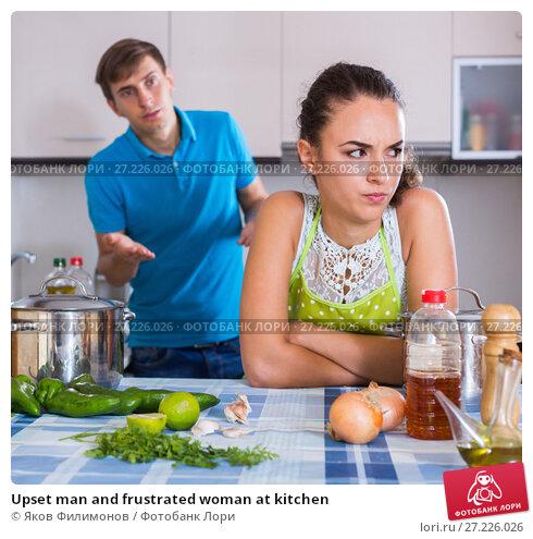 Купить «Upset man and frustrated woman at kitchen», фото № 27226026, снято 26 апреля 2019 г. (c) Яков Филимонов / Фотобанк Лори