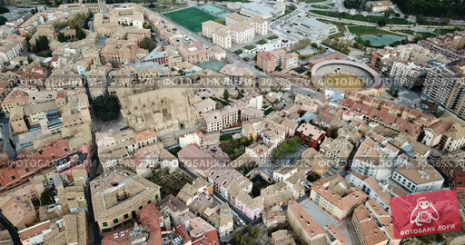 Купить «Urban view from drone of roofs of residential buildings in Spanish city of Huesca», видеоролик № 30385770, снято 24 декабря 2018 г. (c) Яков Филимонов / Фотобанк Лори