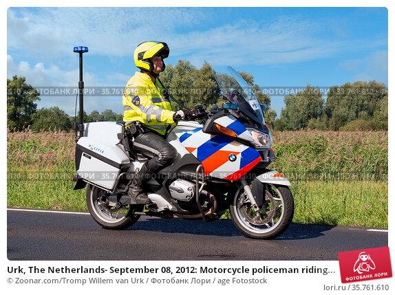 Urk, The Netherlands- September 08, 2012: Motorcycle policeman riding... Стоковое фото, фотограф Zoonar.com/Tromp Willem van Urk / age Fotostock / Фотобанк Лори