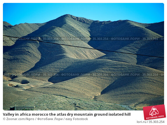 Valley in africa morocco the atlas dry mountain ground isolated hill. Стоковое фото, фотограф Zoonar.com/lkpro / easy Fotostock / Фотобанк Лори