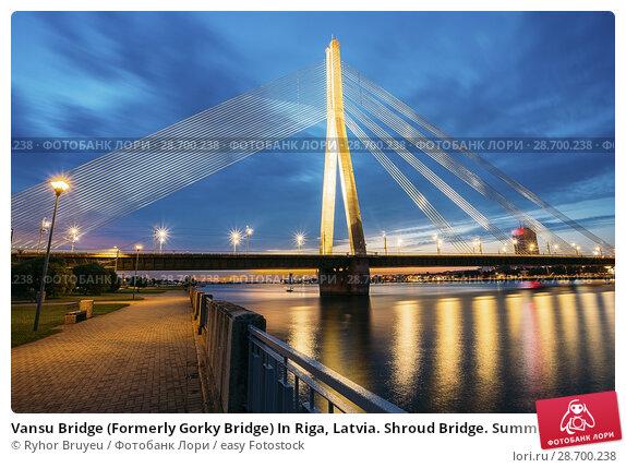 Купить «Vansu Bridge (Formerly Gorky Bridge) In Riga, Latvia. Shroud Bridge. Summer Evening With Blue Sky. 595 Meters In Length. Vansu Bridge - One Of The Symbols Of Modern Riga. Crossing The Daugava River.», фото № 28700238, снято 30 июня 2016 г. (c) easy Fotostock / Фотобанк Лори