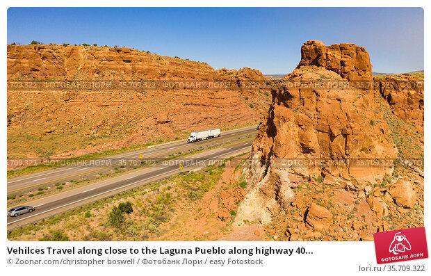 Vehilces Travel along close to the Laguna Pueblo along highway 40... Стоковое фото, фотограф Zoonar.com/christopher boswell / easy Fotostock / Фотобанк Лори