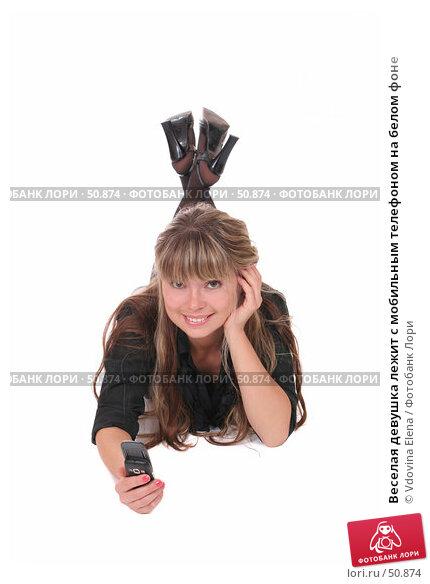 Купить «Веселая девушка лежит с мобильным телефоном на белом фоне», фото № 50874, снято 25 мая 2007 г. (c) Vdovina Elena / Фотобанк Лори