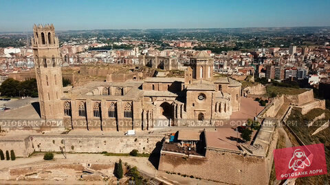 Купить «View from drone of Catalan city of Lleida with medieval Cathedral of St. Mary of La Seu Vella», видеоролик № 30322730, снято 25 июля 2018 г. (c) Яков Филимонов / Фотобанк Лори