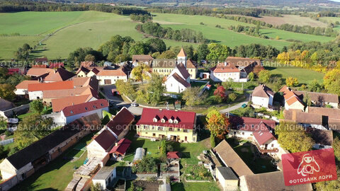 View from drone of old houses of Czech village Cakov in sunny fall day. Стоковое видео, видеограф Яков Филимонов / Фотобанк Лори