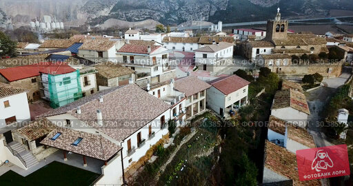 Купить «View from drone of roofs of houses in traditional village of Liedena in foggy morning, Navarre, Spain», видеоролик № 30385790, снято 23 декабря 2018 г. (c) Яков Филимонов / Фотобанк Лори