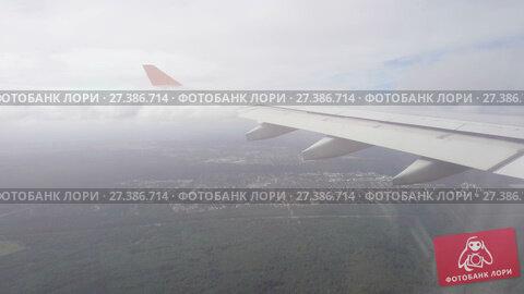 Купить «View from the airplane», видеоролик № 27386714, снято 28 октября 2017 г. (c) Игорь Жоров / Фотобанк Лори