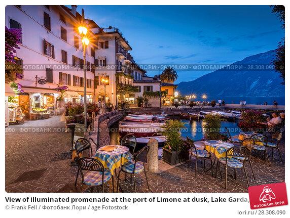 Купить «View of illuminated promenade at the port of Limone at dusk, Lake Garda, Lombardy, Italian Lakes, Italy, Europe», фото № 28308090, снято 16 августа 2017 г. (c) age Fotostock / Фотобанк Лори