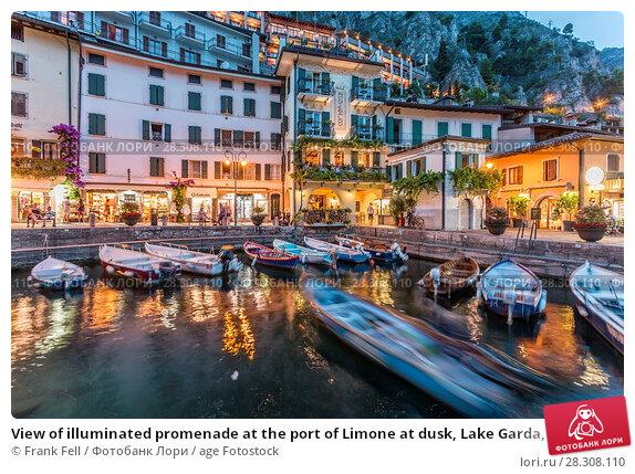 Купить «View of illuminated promenade at the port of Limone at dusk, Lake Garda, Lombardy, Italian Lakes, Italy, Europe», фото № 28308110, снято 16 августа 2017 г. (c) age Fotostock / Фотобанк Лори