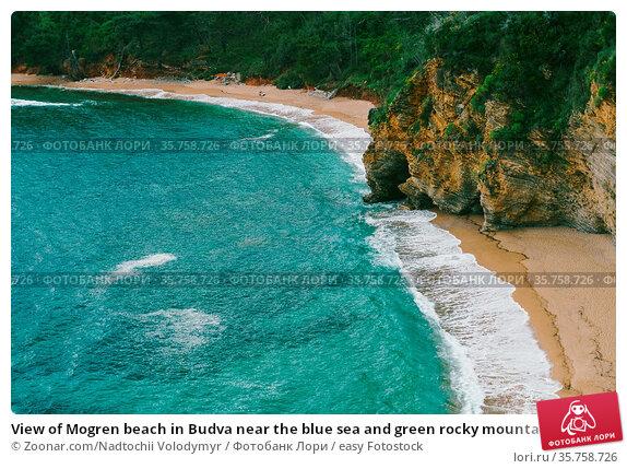 View of Mogren beach in Budva near the blue sea and green rocky mountains... Стоковое фото, фотограф Zoonar.com/Nadtochii Volodymyr / easy Fotostock / Фотобанк Лори