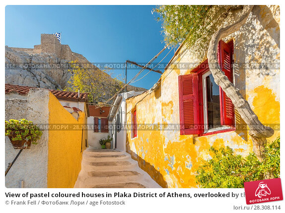 Купить «View of pastel coloured houses in Plaka District of Athens, overlooked by the walls of The Acropolis, Athens, Greece, Europe», фото № 28308114, снято 21 октября 2017 г. (c) age Fotostock / Фотобанк Лори