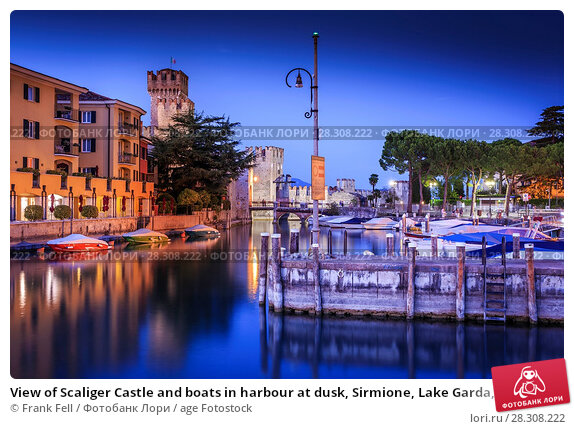 Купить «View of Scaliger Castle and boats in harbour at dusk, Sirmione, Lake Garda, Lombardy, Italian Lakes, Italy, Europe», фото № 28308222, снято 21 августа 2017 г. (c) age Fotostock / Фотобанк Лори
