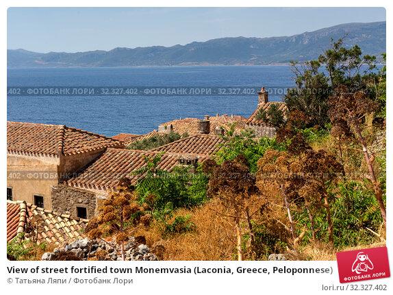 Купить «View of street fortified town Monemvasia (Laconia, Greece, Peloponnese)», фото № 32327402, снято 15 июня 2019 г. (c) Татьяна Ляпи / Фотобанк Лори