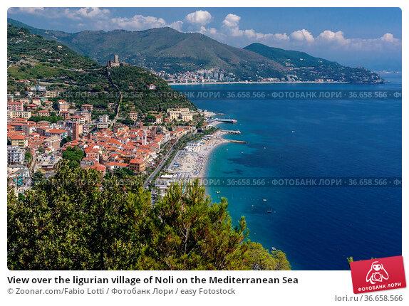 View over the ligurian village of Noli on the Mediterranean Sea. Стоковое фото, фотограф Zoonar.com/Fabio Lotti / easy Fotostock / Фотобанк Лори