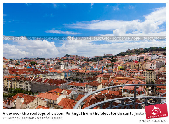 Купить «View over the rooftops of Lisbon, Portugal from the elevator de santa justa or santa just a lift which was built in 1902 to connect lower streets», фото № 30607690, снято 15 июля 2018 г. (c) Николай Коржов / Фотобанк Лори