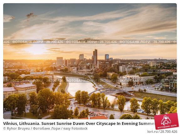 Купить «Vilnius, Lithuania. Sunset Sunrise Dawn Over Cityscape In Evening Summer. Beautiful View Of Modern Office Buildings Skyscrapers In Business District New City Centre Shnipishkes.», фото № 28700426, снято 5 июля 2016 г. (c) easy Fotostock / Фотобанк Лори