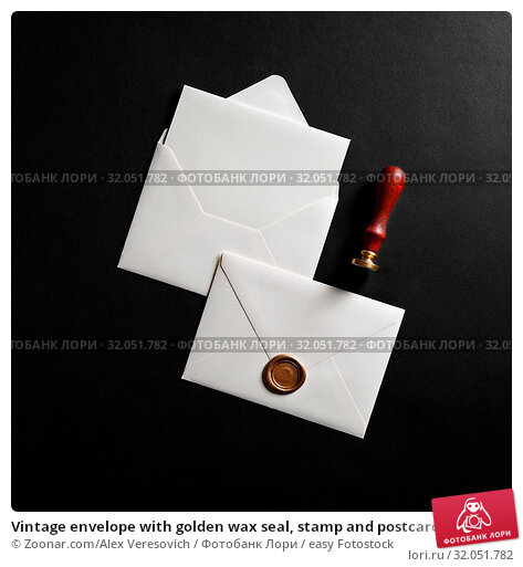 Vintage envelope with golden wax seal, stamp and postcard on black paper background. Flat lay. Стоковое фото, фотограф Zoonar.com/Alex Veresovich / easy Fotostock / Фотобанк Лори