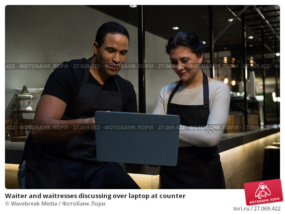 Waiter and waitresses discussing over laptop at counter, фото № 27069422, снято 28 мая 2017 г. (c) Wavebreak Media / Фотобанк Лори