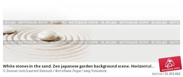 White stones in the sand. Zen japanese garden background scene. Horizontal... Стоковое фото, фотограф Zoonar.com/Laurent Davoust / easy Fotostock / Фотобанк Лори