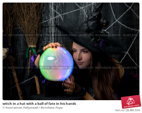 Купить «witch in a hat with a ball of fate in his hands», фото № 26981514, снято 3 октября 2016 г. (c) Константин Лабунский / Фотобанк Лори