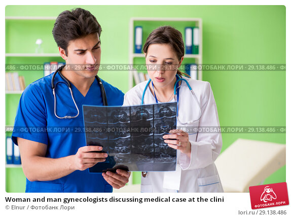 Купить «Woman and man gynecologists discussing medical case at the clini», фото № 29138486, снято 5 июня 2018 г. (c) Elnur / Фотобанк Лори