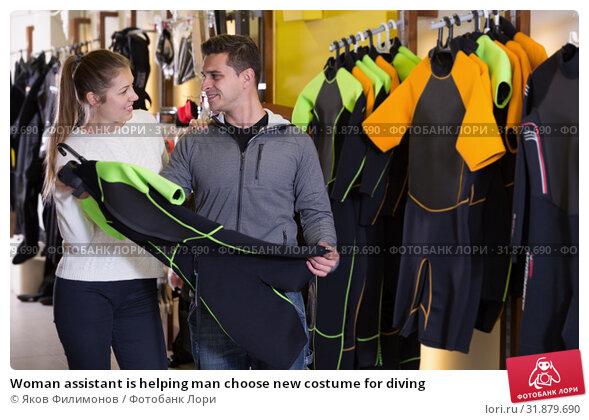 Купить «Woman assistant is helping man choose new costume for diving», фото № 31879690, снято 25 января 2018 г. (c) Яков Филимонов / Фотобанк Лори
