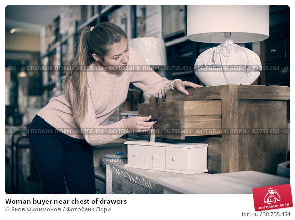 Купить «Woman buyer near chest of drawers», фото № 30755454, снято 15 ноября 2017 г. (c) Яков Филимонов / Фотобанк Лори
