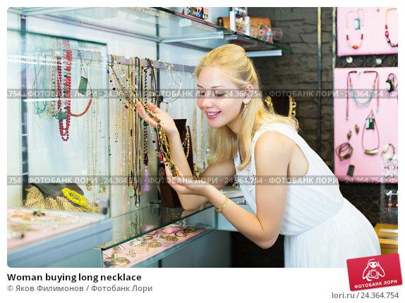 Купить «Woman buying long necklace», фото № 24364754, снято 25 марта 2019 г. (c) Яков Филимонов / Фотобанк Лори