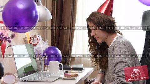 Купить «Woman celebrating birthday from home», видеоролик № 33706334, снято 19 апреля 2020 г. (c) Сергей Петерман / Фотобанк Лори